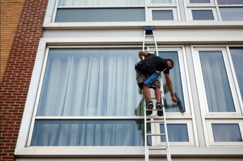window cleaner on secure latter